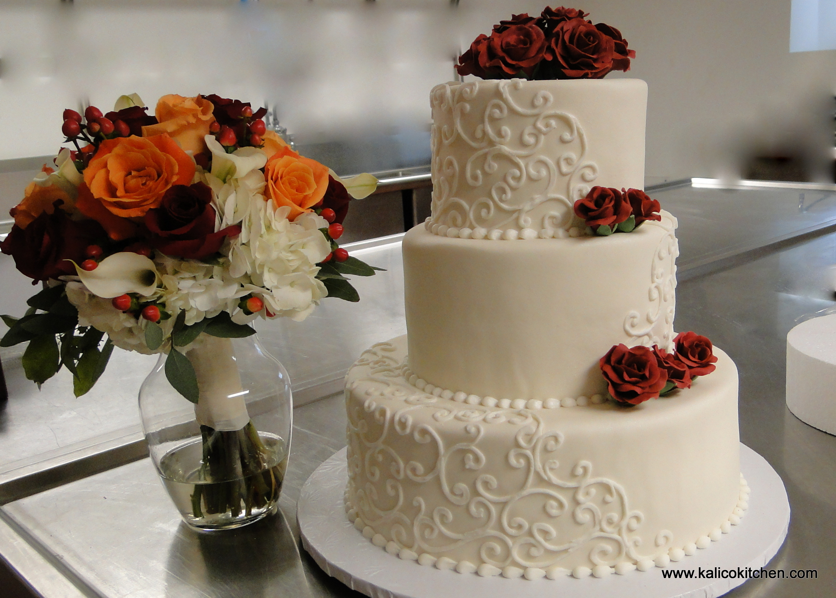 Wedding-Cakes-three-tier-fondant-white-scrolls-red-sugar-roses-Walkerton-Tavern